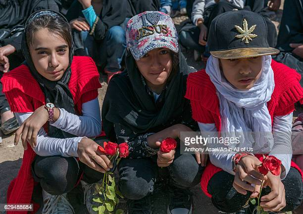 Iranian girls wearing caps with i love jesus slogan and a marijuana leaf Lorestan Province Khorramabad Iran on October 11 2016 in Khorramabad Iran