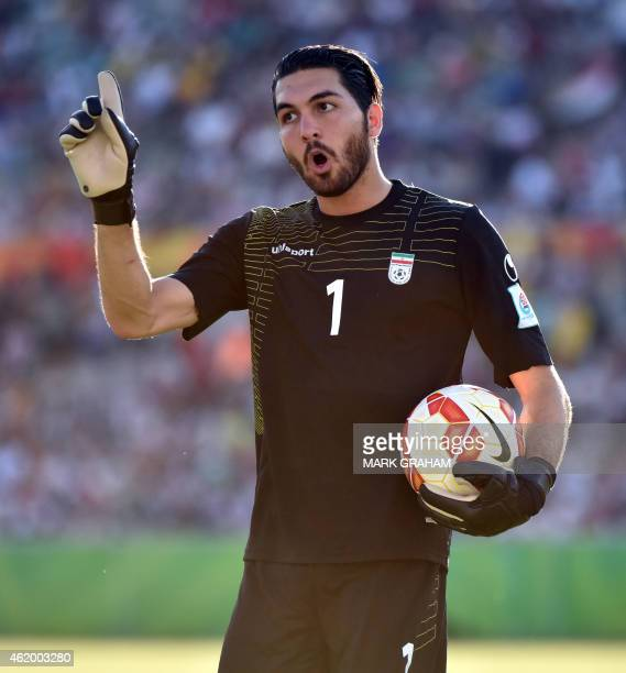 Iranian goal keeper Alireza Haghighi gestures during the Asian Cup quarterfinal football match between Iraq and Iran in Canberra on January 23 2015...