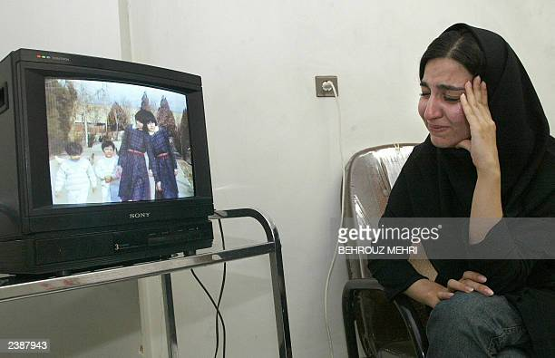 Iranian Golnaz Safaeian the estranged adoptive sister of Iranian twins Laleh and Ladan Bijani cries as she watches a video of the twins in Tehran 08...