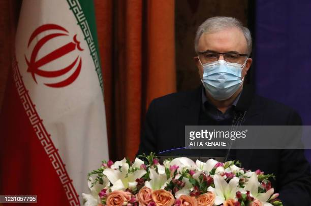 Iranian Health Minister Saeed Namaki looks on during a ceremony to launch the country's COVID-19 vaccination campaign, at the Imam Khomeini hospital...