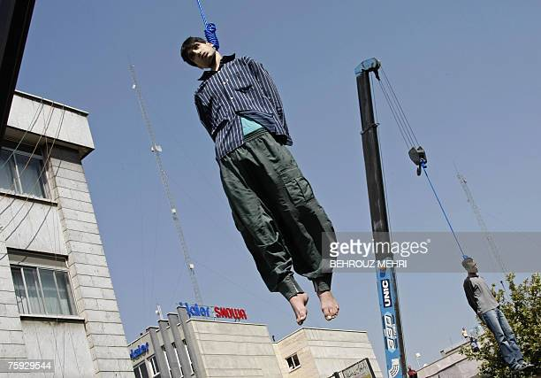 Iranian Hossein Kavousifar and Majid Kavousifar are hanged in public in central Tehran 02 August 2007 Two men convicted of murdering a top Iranian...