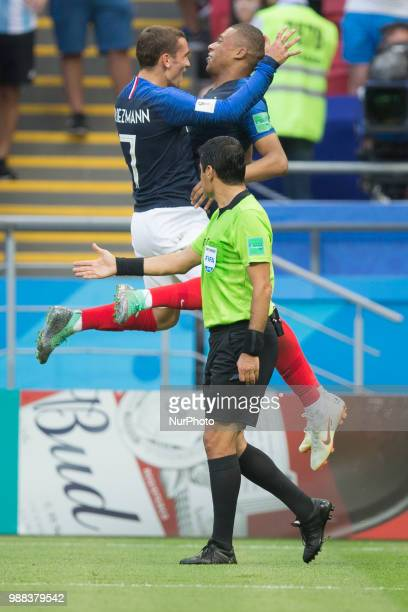 Iranian international football referee Alireza Faghani looks Antoine Griezmann and Kylian Mbappe of France celebrate during the 2018 FIFA World Cup...