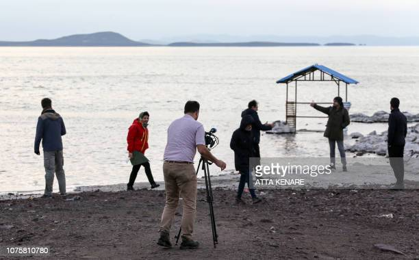 Iranian journalists visit the salt lake of Urmia in the country's northwest which had been shrinking in one of the worst ecological disasters of the...