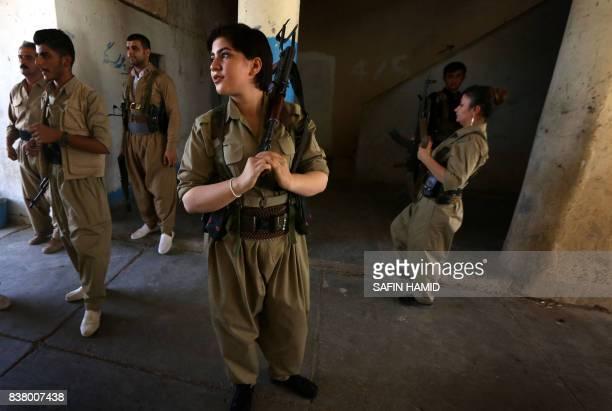 Iranian Kurdish Peshmerga members of the Iranian Kurdistan Democratic Party take part in routine military exercise in Koya, 100 kms east of Arbil,...