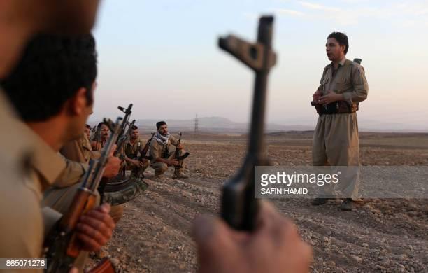 Iranian Kurdish Peshmerga, members of the Iranian Kurdistan Democratic Party , take part in routine military exercise in Koya, 100 kms east of Arbil,...