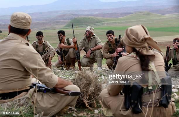 Iranian Kurdish Peshmerga members of the Kurdistan Democratic Party of take part in routine military exercises in Koya 100 kms east of Arbil the...