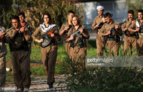 Iranian Kurdish Peshmerga members of the Kurdistan Democratic Party of take part in a training as they prepare to celebrate Noruz the Persian New...