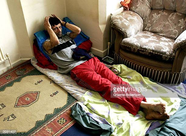 Iranian Kurdish refugee Abas Amini sits in protest with his eyes mouth and ears sewn shut May 27 2003 in Nottingham England The 33yearold...