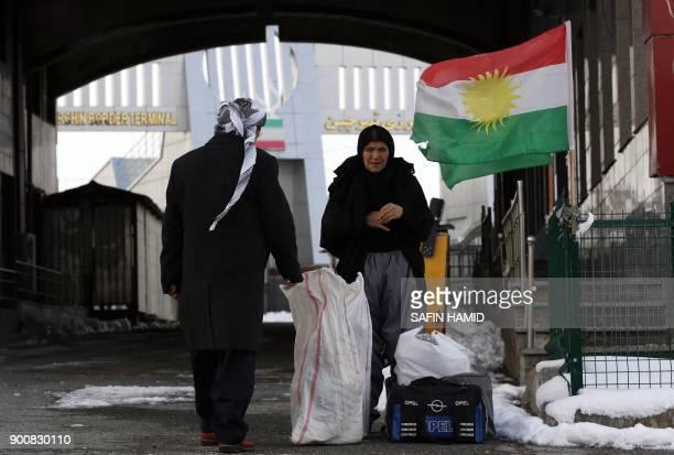 Iranian Kurds arrive at the IranIraq border crossing of Haji Omran on January 3 one day after two border posts were reopened between Iraqi Kurdistan...
