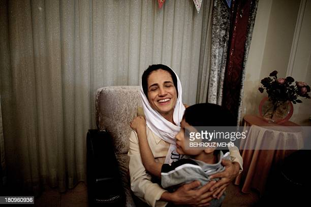 Iranian lawyer Nasrin Sotoudeh hugs get son Nima at her home in Tehran on September 18 after being freed after three years in prison Sotoudeh told...