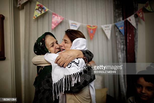 Iranian lawyer Nasrin Sotoudeh hugs her motherinlaw at her house in Tehran on September 18 after being freed after three years in prison Sotoudeh...