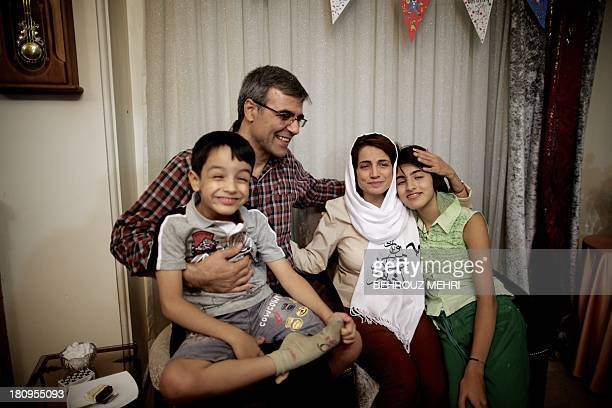 Iranian lawyer Nasrin Sotoudeh poses with her husband Reza Khandan her son Nima and her Daughter Mehraveh at herat her home in Tehran on September 18...