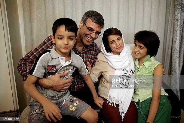 Iranian lawyer Nasrin Sotoudeh poses with her husband Reza Khandan her son Nima and her Daughter Mehraveh at her house in Tehran on September 18...