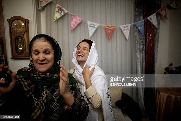 Iranian lawyer Nasrin Sotoudeh smiles after hugging her motherinlaw at her home in Tehran on September 18 following her release from three years in...