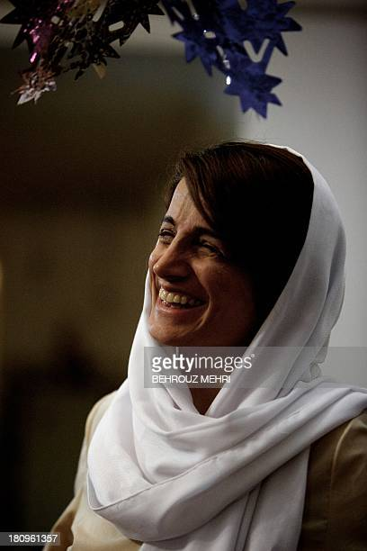 Iranian lawyer Nasrin Sotoudeh smiles at her home in Tehran on September 18 after being freed after three years in prison Sotoudeh told AFP she was...