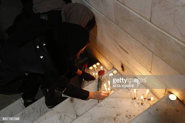 Iranian light candles and lay flowers in front of a fire station in downtown Tehran on January 20 in honour of the trapped firefighters following the...