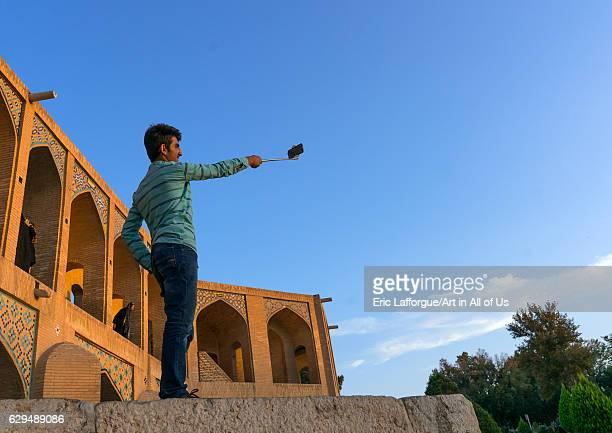 Iranian man taking a selfie on Khaju bridge Pol-e Khaju, Isfahan Province, Isfahan, Iran on October 13, 2016 in Isfahan, Iran.