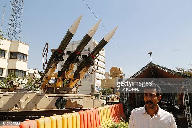 AN Iranian man walks past Sam6 missiles displayed in the street during a war exhibition to commemorate the 198088 IranIraq war at Baharestan square...