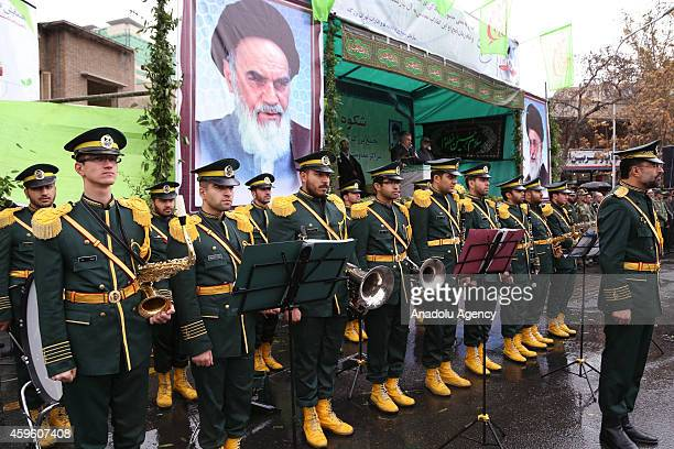 Iranian marching band perform during a rally marking the 35th anniversary of the Basij , a paramilitary volunteer militia established in 1979 by...