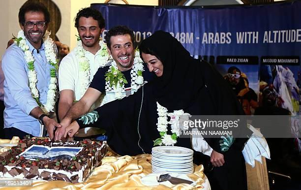 Iranian Masoud Mohammed Qatari Sheikh Mohammed Bin Abdullah AlThani Palestinian Raed Zidan and Saudi Arabian Raha Moharrak cut a cake upon their...