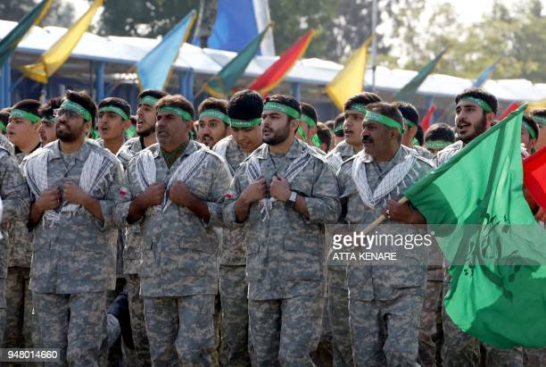 Iranian members of the Basij militia march during a parade on the occasion of the country's annual army day on April 18 2018 in Tehran President...