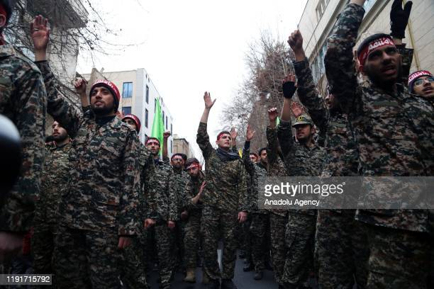 Iranian members of the Basij militia take part in an anti-US rally to protest the killing of Iranian Revolutionary Guards' Quds Force commander Qasem...