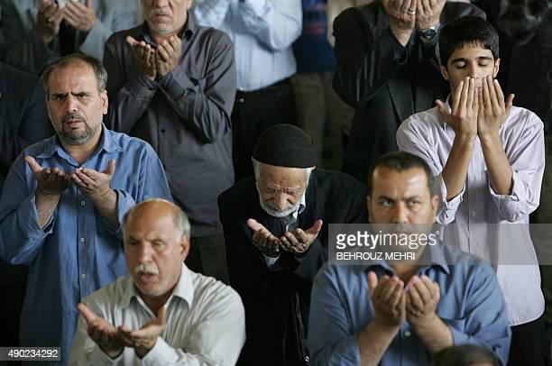 Iranian men pray during the Friday prayers at Tehran University on October 16 2009 In the Friday preayer sermon Guardian Council head Ahmad Jannati...
