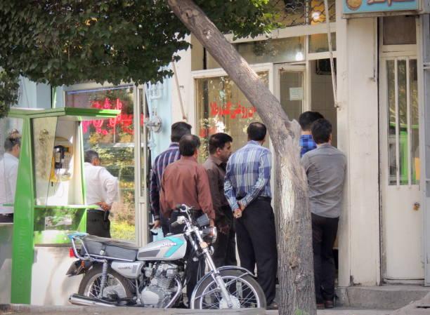 Iranian men queue for bread, part of daily life in Tabriz, Iran