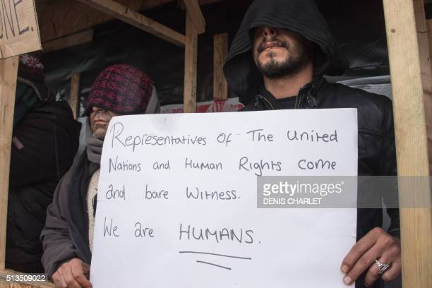 Iranian migrants who sew their lips to protest against the dismantling of the southern half of the socalled 'Jungle' migrant camp stage a protest in...