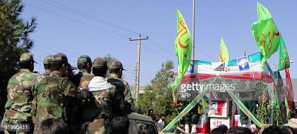 Iranian military attend a funeral procession for Iran's elite Revolutionary Guards and local tribesmen in Zahedan near the Pakistani border on...