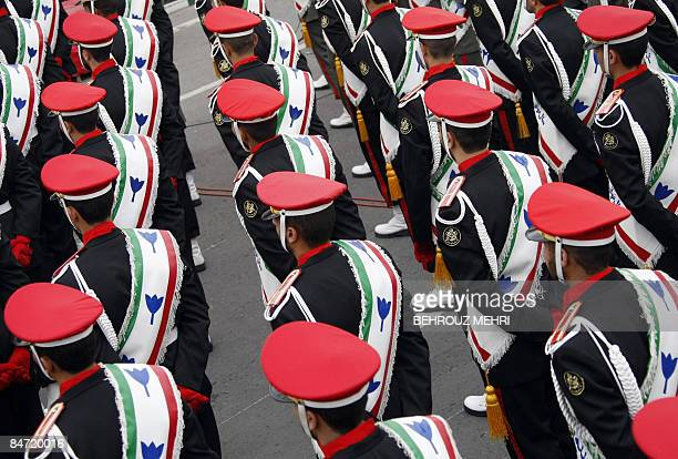 Iranian military policemen stand guard during a rally marking the 30th anniversary of the Islamic revolution in Tehran on February 10 2009 Tens of...