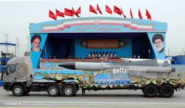 A Iranian military truck carrying a missile drives in front of the officials' stand during a military parade marking the annual National Army Day in...
