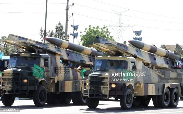 Iranian military trucks carry surfacetoair missiles during a parade on the occasion of the country's Army Day on April 18 in Tehran / AFP PHOTO /...