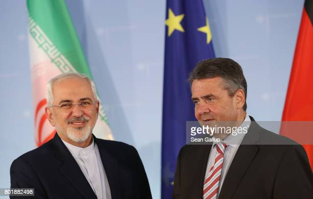Iranian Minister of Foreign Affairs Mohammad Javad Zarif and German Foreign Minister Sigmar Gabriel prepare to depart after speaking to the media...