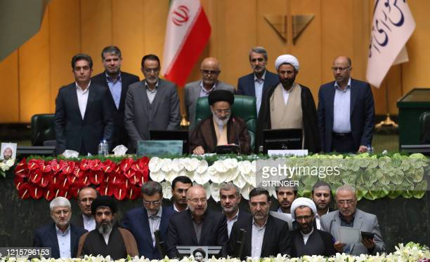 Iranian Mohamad Bagher Ghalibaf stands among members of the parliament after being elected as parliament speaker at the Iranian parliament in Tehran...