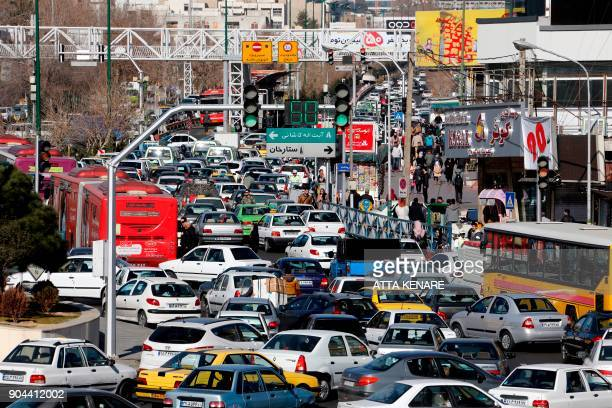 Iranian motorists drive in Sadeqyeh Square in the capital Tehran on January 13 2018 Iran rejected any modification of its nuclear deal with world...