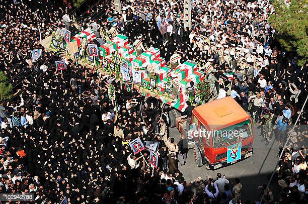 Iranian mourners attend the mass funeral of those killed in twin suicide bombings targeting a Shiite mosque in the southeastern Iranian city of...