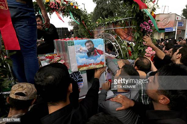 Iranian mourners carry the coffins of Mohammad Hamidi Hasan Ghafari and Ali Amrai members of the Islamic Republic's Revolutionary Guards reportedly...