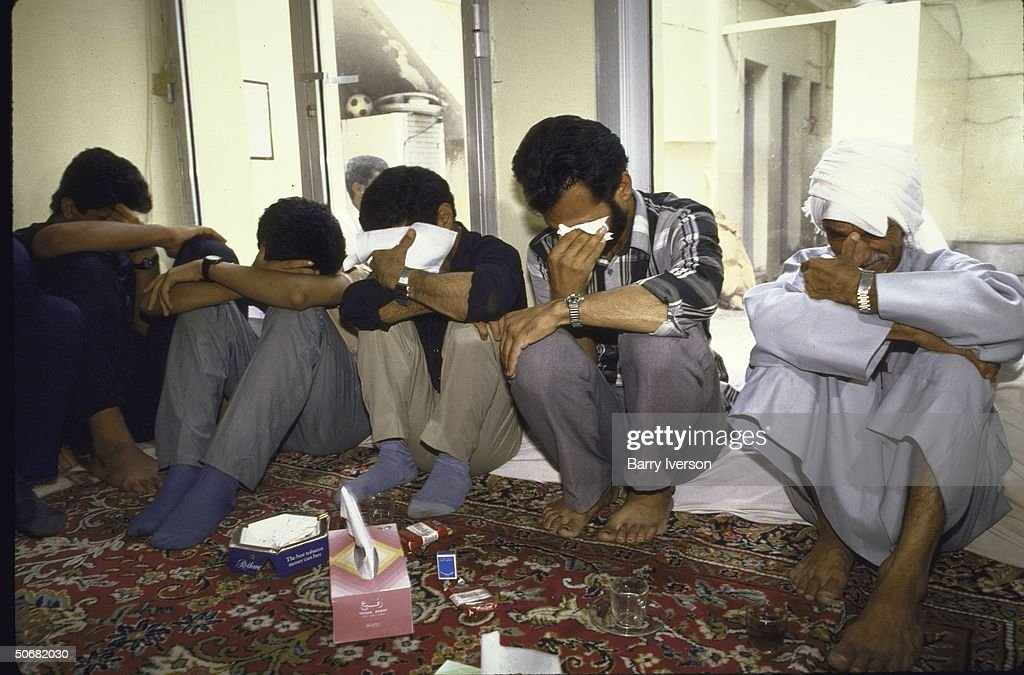 Iranian mourners crying over the dead victims of the Iranian Airbus that was shot down by the USS Vincennes in the Persian Gulf.