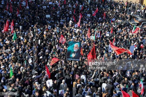 Iranian mourners gather during the final stage of funeral processions for slain top general Qasem Soleimani, in his hometown Kerman on January 7,...