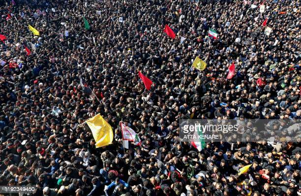 TOPSHOT Iranian mourners gather during the final stage of funeral processions for slain top general Qasem Soleimani in his hometown Kerman on January...