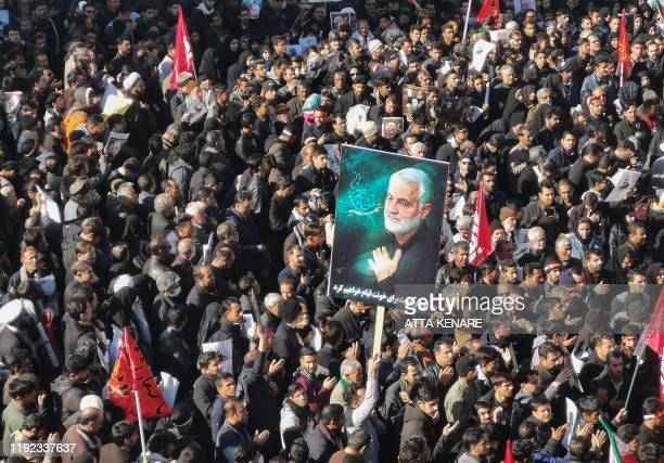 Iranian mourners gather for the burial of slain top general Qasem Soleimani in his hometown Kerman on January 7, 2020. - Soleimani was killed outside...