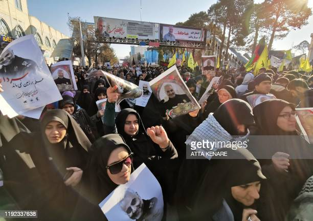 Iranian mourners gather for the burial of slain top general Qasem Soleimani in his hometown Kerman on January 7 2020 Soleimani was killed outside...