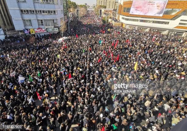TOPSHOT Iranian mourners gather for the burial of slain top general Qasem Soleimani in his hometown Kerman on January 7 2020 Soleimani was killed...
