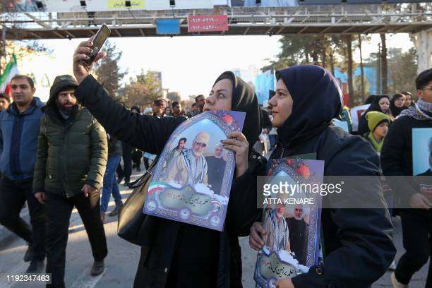 Iranian mourners take a selfie during the final stage of funeral processions for slain top general Qasem Soleimani in his hometown Kerman on January...