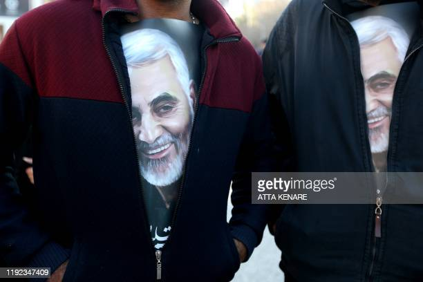 TOPSHOT Iranian mourners wearing tshirts with pictures of slain top general Qasem Soleimani during the final stage of funeral processions in his...