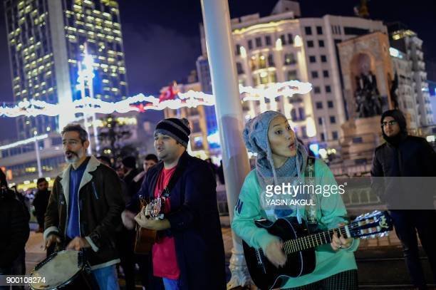 Iranian musicians play close to Taksim square where Turkish security forces are on patrol as people prepare to celebrate the New Year in Istanbul on...