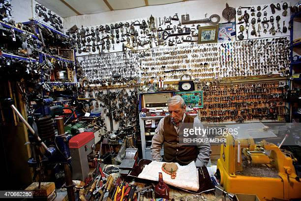 Iranian Muslim locksmith Ali Bagherian prays inside his shop owned by his family for almost one hundred years at the heart of the Armenian Julfa...