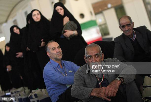 Iranian Muslim pilgrims wait in line at King Abdul Aziz airport upon their arrival to the Red Sea port city of Jeddah on November 27 2008 Muslim...
