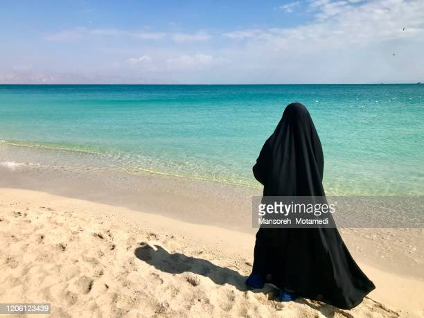 iranian muslim woman with hijab infront of persian gulf - iran stock pictures, royalty-free photos & images